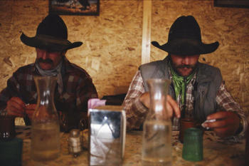 a-pair-of-cowboys-enjoy-a-cup-of-coffee-joel-sartore